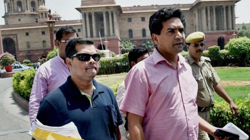 Sacked Delhi minister Kapil Mishra outside the the Mnistry of Finance at North Block in New Delhi on Wednesday. (Photo: PTI)