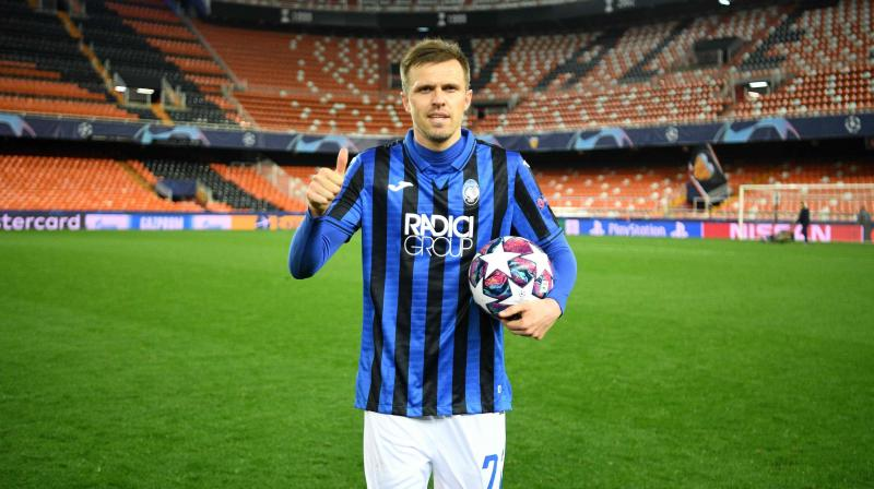 Atalanta's Slovenian midfielder Josip Ilicic celebrates after the UEFA Champions League round of 16 second leg match against Valencia at Estadio Mestalla, Valencia, on March 10. AFP Photo