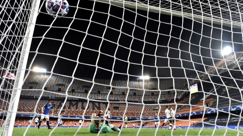 Atalanta's Josip Ilicic scores his side's third goal during the Champions League round of 16 second leg match against Valencia in Valencia, Spain, on Tuesday. AP Photo