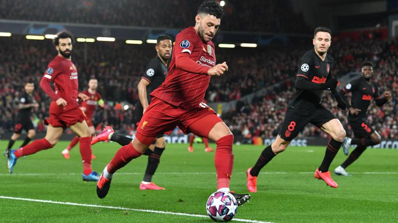 Liverpool's English midfielder Alex Oxlade-Chamberlain controls the ball during the UEFA Champions league Round of 16 second leg football match against Atletico Madrid at Anfield in Liverpool, north west England, on March 11, 2020. AFP Photo