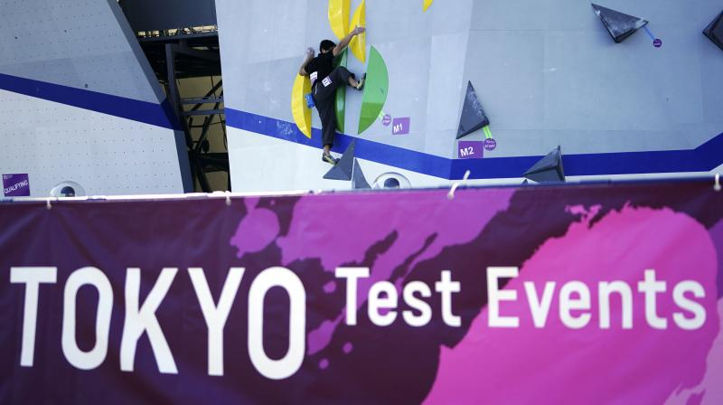 A Tokyo 2020 Olympic Games Organizing staff climbs the wall in the test event of Speed Climbing in preparation for the Tokyo 2020 Olympic Games at Aomi Urban Sports Park in Tokyo last week. AP Photo
