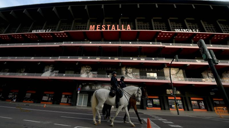 Mounted Spanish policemen patrol outside the Mestalla stadium in Valencia before the UEFA Champions League round of 16 second leg  football between Valencia and Atalanta on March 10. AFP Photo