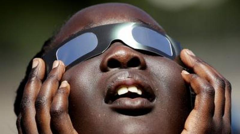 During a solar eclipse, The sun's view is blocked from earth by the passing moon eithe partially or completely.
