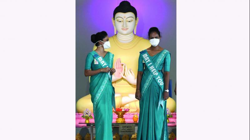 Sri Lankan airport officials with facemasks at Bandaranaike International airport in Katunayake on Friday. (Photo: AFP)
