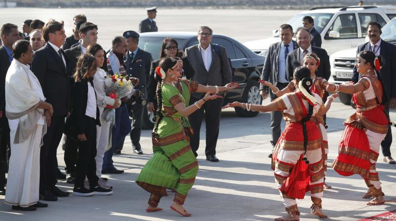 Brazilian President Jair Bolsonar watches a classical dance upon his arrival at the Air Force Station in New Delhi on Friday. (Photo: AP)