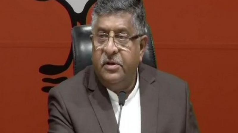 RS Prasad speaking to media on Thursday. 'All ministers including myself had gone to visit the families of those who lost their lives in the Pulwama attack. But, it is our firm belief that the country should not stop progressing and there should be no halt in any developmental work,' said Union Minister RS Prasad. (Photo: ANI)