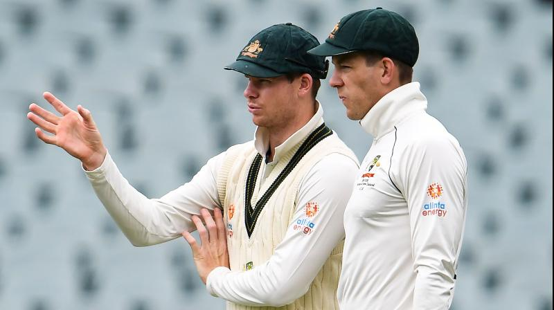 HEALTHY RELATIONSHIP: Current Australian Test captain Tim Paine (R) takes advise from former skipper Steve Smith during a Test match against Pakistan in Adelaide. AFP