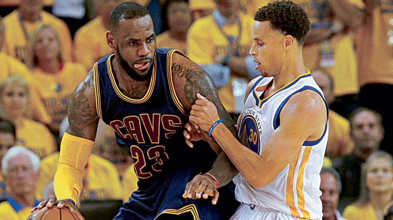 LeBron James of Cleveland Cavaliers and Stephen Curry of Golden State Warriors in the thick of things in the battle for the 2016 NBA crown. DC File Photo