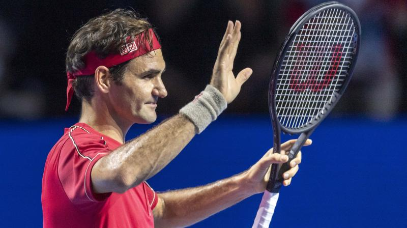 Roger Federer acknowledges the crowd after winning the Swiss Indoors title last year, beating Alex de Minaur of Australia 6-2, 6-2 in the final. AP Photo