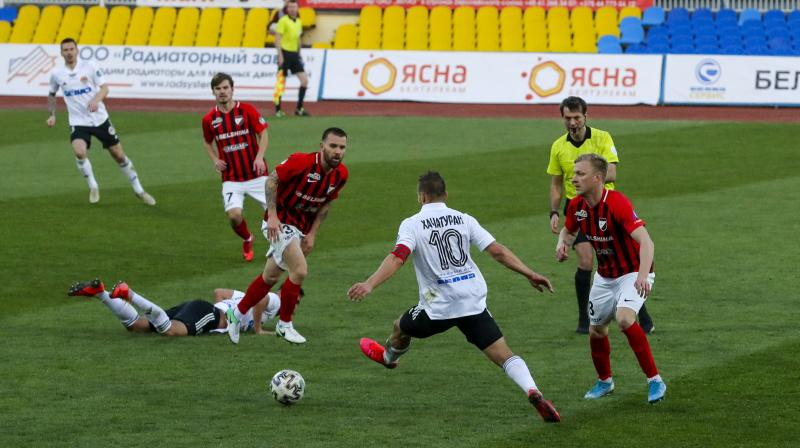 In this photo taken on March 27, 2020, players in action during a Belarus Championship soccer match in the town of Zhodino, Belarus. Longtime Belarus President Alexander Lukashenko is proudly keeping soccer and hockey arenas open even though most sports around the world have shut down because of the coronavirus pandemic. AP Photo