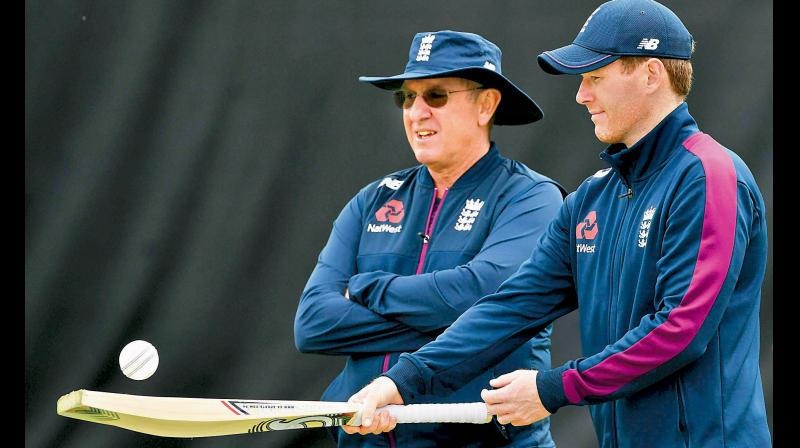 England captain Eoin Morgan (R) attends a training session with head coach Trevor Bayliss. AFP Photo