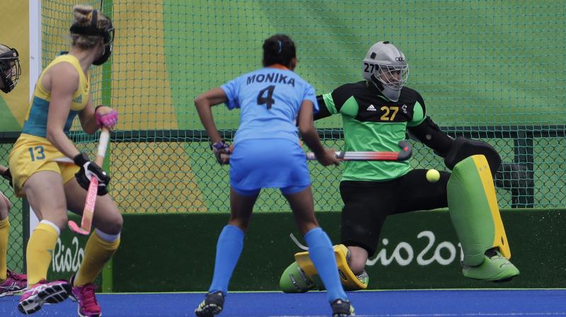 In this file photo, Australia's goalkeeper Rachael Lynch saves the ball against India's Monika (C) at the 2016 Summer Olympics in Rio de Janeiro, Brazil. AP Photo