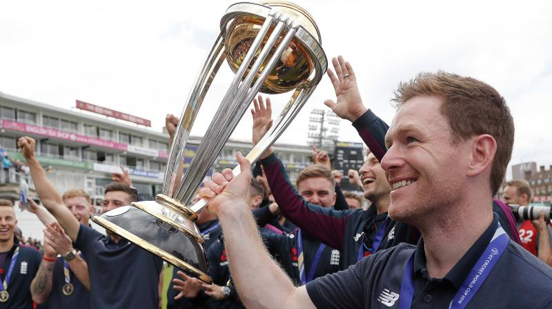 England captain Eoin Morgan and his teammates with the World Cup at The Oval in London. AP Photo