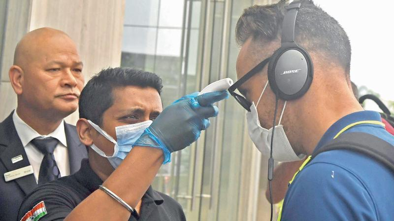 Staff of a Kolkata hotel where the South African cricketers stayed on their way home checking Faf du Plessis' temperature. DC File Photo