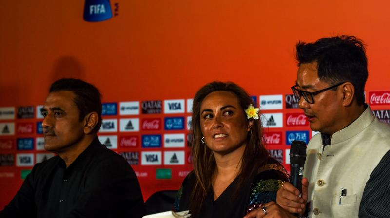 Chief Women's Football Officer for FIFA, Sarai Bareman (C) looks on as sports minister Kiren Rijiju (R) speaks in the presence of AIFF president Praful Patel during the unveiling of the FIFA U-17 Women's World Cup India 2020 Official Emblem in Mumbai on November 2, 2019. AFP Photo