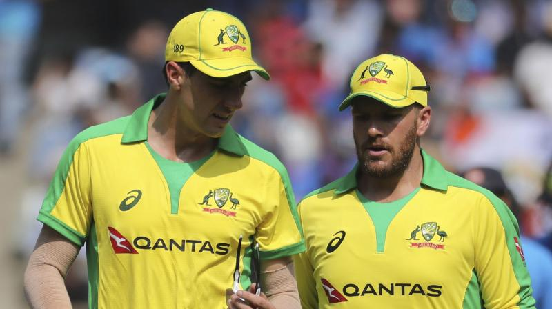 Pat Cummins with his one-day skipper Aaron Finch. AP Photo