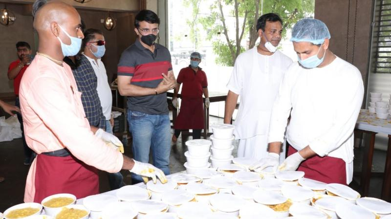 BCCI president and forme India cricket captain Sourav Ganguly at ISKCON Kolkata with its official Radharam Das (2nd R) on Saturday.