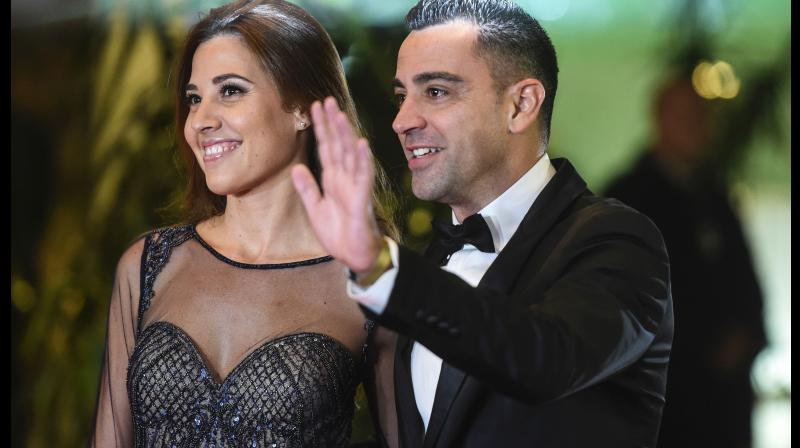 Former Barcelona football player Xavi Hernandez and his wife Nuria Cunillera. AFP Photo