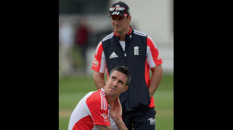 File photo of Kevin Pietersen (sitting) with his skipper Andrew Strauss. DC File Photo