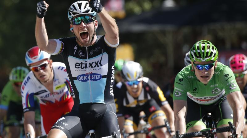 Britain's cyclist Mark Cavendish celebrates as he crosses the finish line ahead of Germany's Andre Greipel in the seventh stage of the Tour de France in 2015. AP Photo