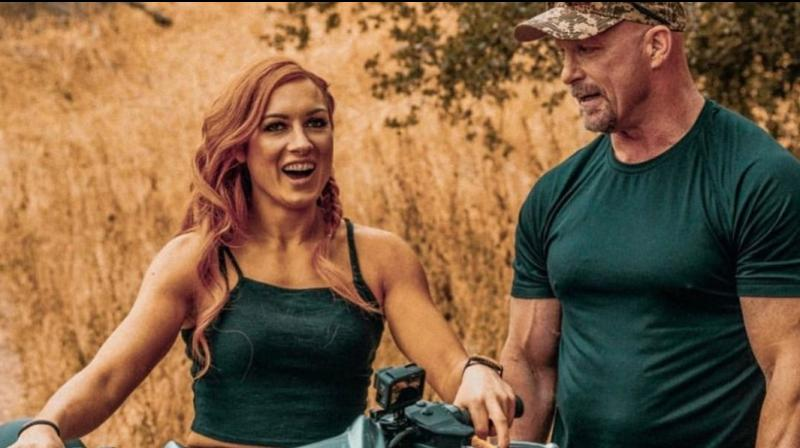 Recently, a video has gone viral on the social media, in the video the former WWE superstar can be seen asking WWE Raw Women's Champion Becky Lynch to have a beer drinking session with the WWE Hall of Famer. 'The Man' accepted the invitation but in the end the 'Irish Lass-kicker' stunned the Stone Cold Steve Austin with his own move. (Photo: Twitter)