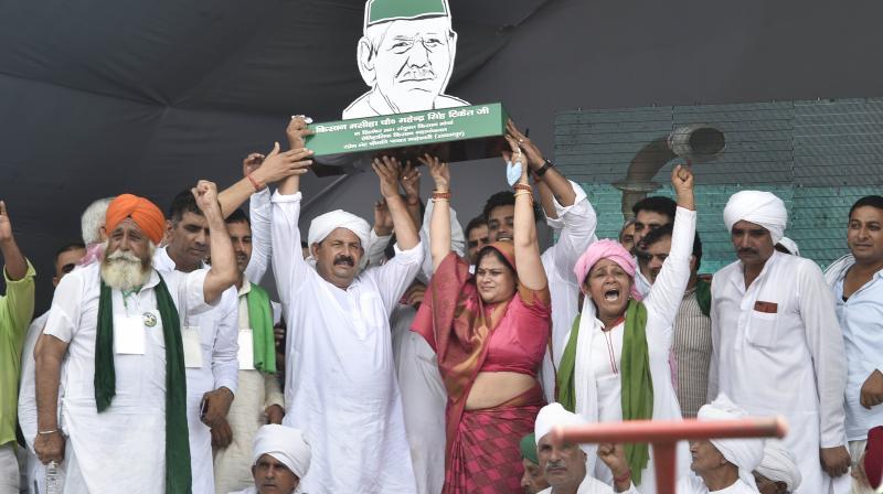 Farmer's leaders attend 'Kisan Mahapanchayat' over the ongoing farmers' agitation against Centre's farm reform laws, in Muzaffarnagar, Sunday, Sept. 5, 2021. (PTI/Shahbaz Khan)