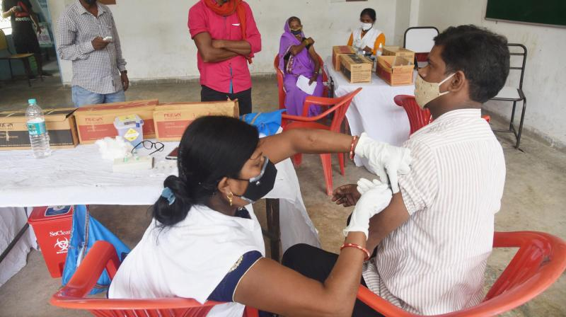 A medic receives a dose of COVID-19 vaccine at Central School Campus in Patna. (Photo: PTI)