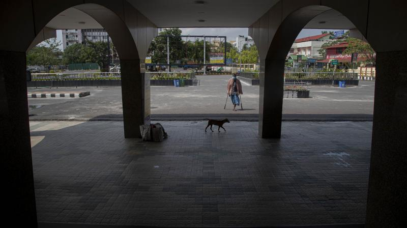 A physically disabled man walks outside a deserted railway station in Guwahati on April 19, 2020. (AP)