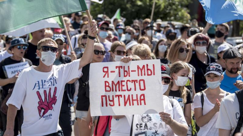 Thousands of demonstrators have again gathered in the major Russian Far East city of Khabarovsk to denounce the arrest of the region's governor a month ago and to support opposition politician Alexei Navalny and Belarusian people. (AP)