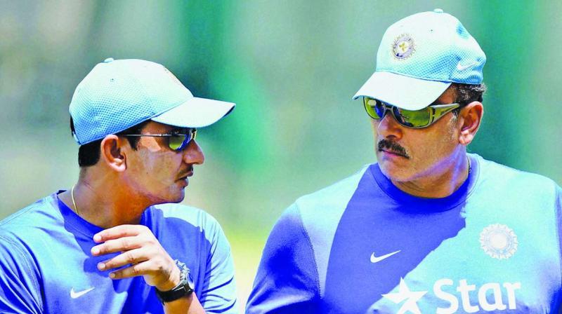 Sanjay Bangar and Ravi Shastri.