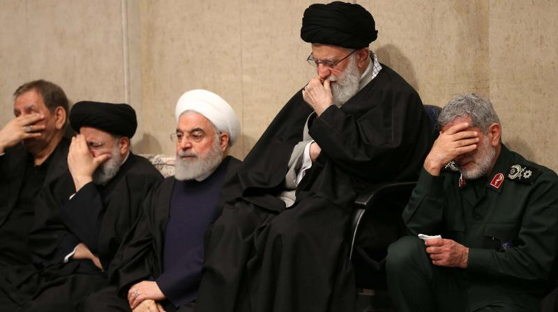 A handout picture of Iran's Supreme Leader Ayatollah Ali Khamenei with President Hassan Rouhani and newly-appointed commander of the Quds Force of the Islamic Revolutionary Guard Corps Esmail Qaani (right) during a mourning ceremony for slain Gen. Qasem Soleimani, in Tehran on Thursday. (Photo: AFP)