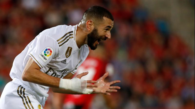 Real Madrid's French forward Karim Benzema reacts to missing a goal opportunity during the Spanish league football match RCD Mallorca against Real Madrid CF. Real Madrid suffered the first defeat of the season. (Photo: AFP)