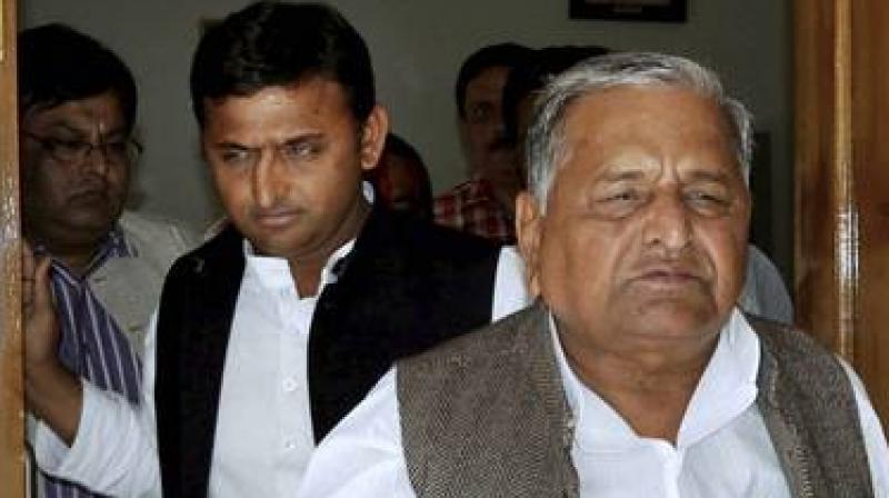 Uttar Pradesh Chief Minister Akhilesh Yadav and Samajwadi Party supremo Mulayam Singh Yadav. (Photo: PTI/File)