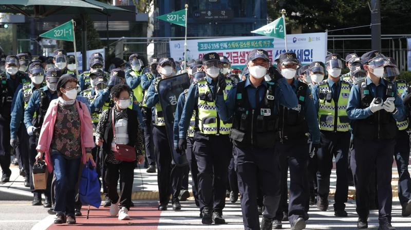South Korean police officers wearing face masks and face shields patrol to block protesters' possible rallies against the government in Seoul, South Korea, Friday, Oct. 9, 2020. Seoul city temporarily banned outdoor rallies with 10 or more people over infection risks against the spread of the coronavirus. (AP)