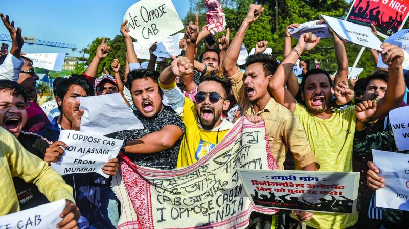 SP workers hold placards and shout slogans during a protest against Citizenship Amendment Act. (Photo: PTI)