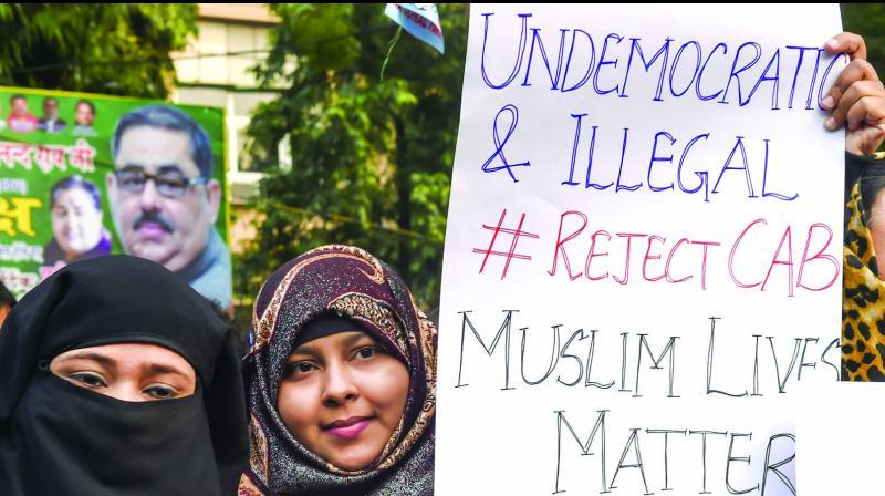 Protesters demand withdrawal of amended Citizenship Act at Jantar Mantar in New Delhi on Saturday. (Photo: PTI)