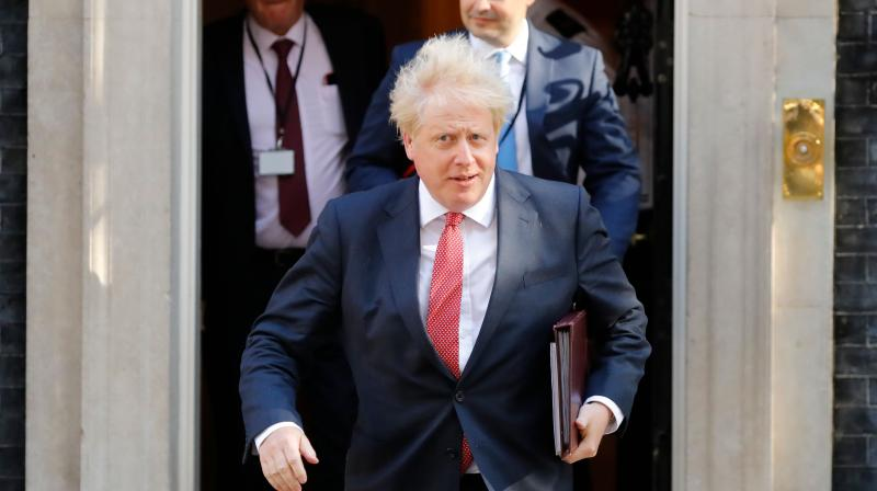 British Prime Minister Boris Johnson leaves 10 Downing Street in central London to head the first in person cabinet meeting since the coronavirus lockdown. (AFP)