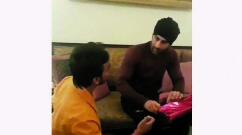 A video of the actor has gone viral where a fan greets the actor by touching his feet. The fan that brought gifts for the actor is seen sitting on the floor, while Ranbir sits on the sofa.