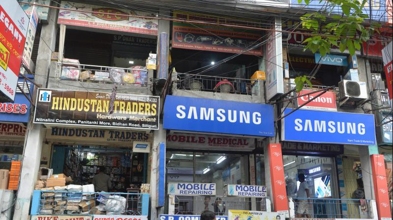 A market complex is seen open after the government eased a nationwide lockdown imposed as a preventive measure against the COVID-19 coronavirus, in Siliguri. PTI Photo