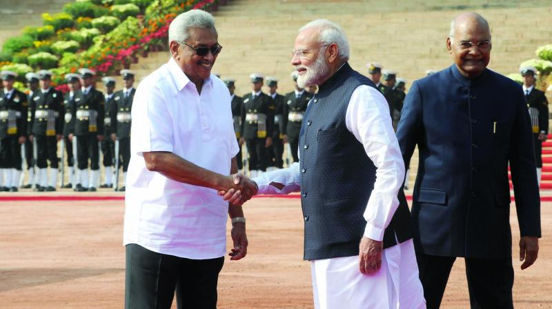 Prime Minister Narendra Modi greets Sri Lankan President Gotabaya Rajapaksa as President Ram Nath Kovind looks on during a ceremonial reception at Rashtrapati Bhavan in New Delhi on Friday. (Photo: Sondeep Shankar)