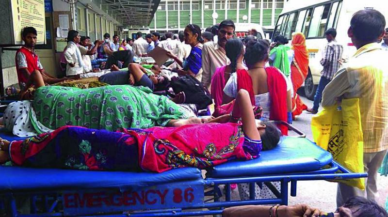 Patients wait to get admitted in AIIMS.