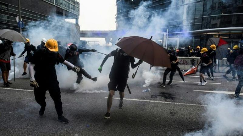 Saturday's clashes saw police baton-charge protesters and fire tear gas, while demonstrators threw rocks and bottles later into the night in a working-class neighbourhood. (Photo: AFP)