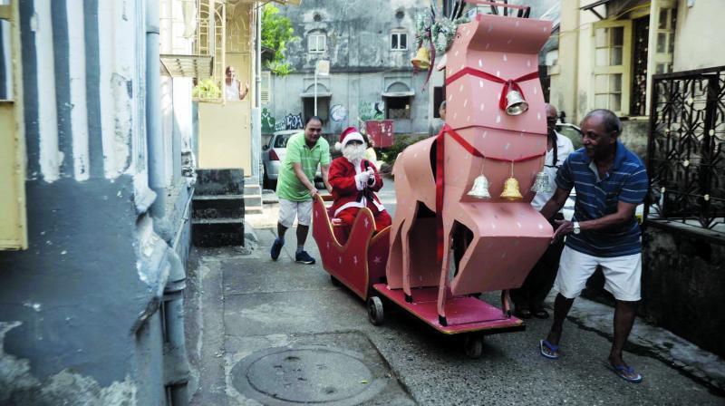 Santa arrives on a wooden sleigh (Photo: Shripad Naik)