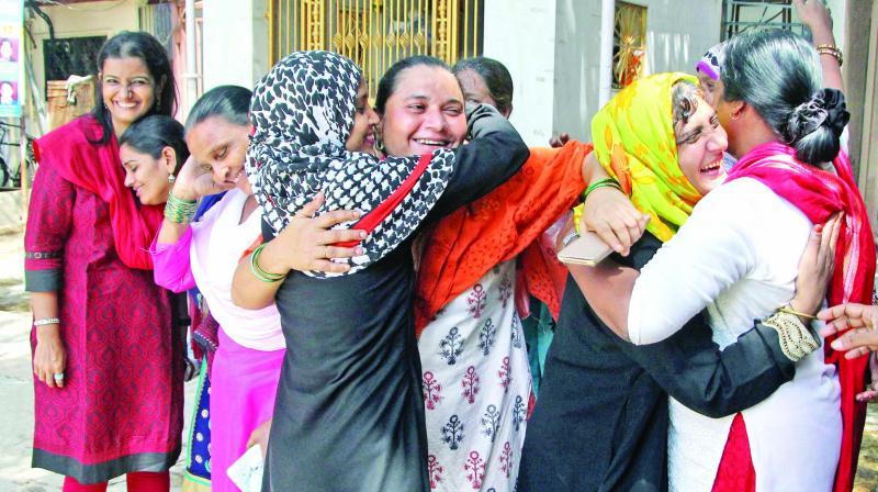 Women celebrate Supreme court's decision to strike down triple talaq.