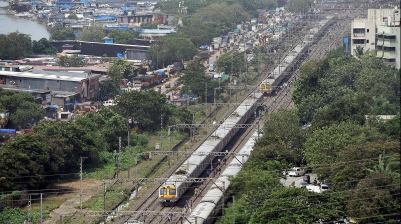 A view of the queued up local trains on railway tracks as the suburban train services remain disrupted after heavy rains in Mumbai. (Photo: Pti)
