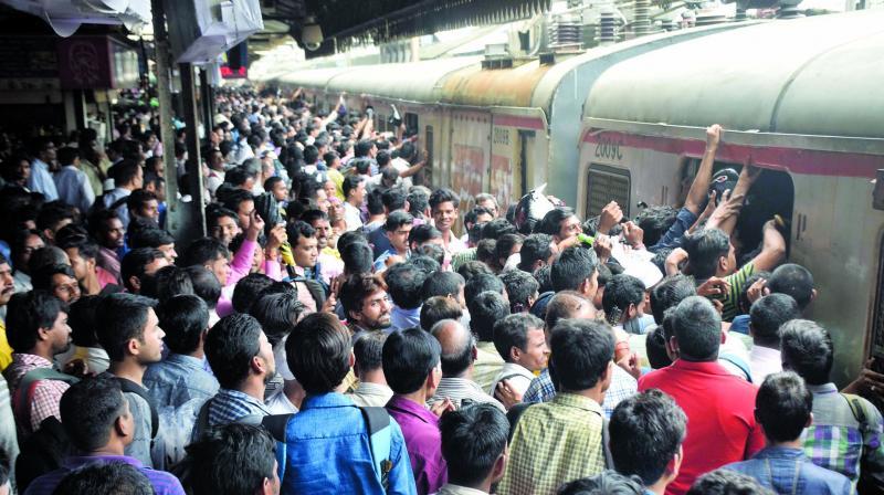Huge crowds were witnessed at the Thane station after train services resumed at 6:30 am on. (Photo: Deepak Kurkunde)