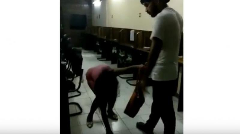 Rohit Tomar was seen brutally thrashing and kicking the woman with his knees and dragging her by her hair as she pleads for mercy. (Photo: YouTube | Screengrab)
