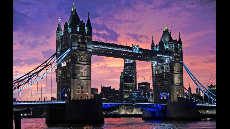 The lit gothic-style Tower Bridge, one of London's oldest landmarks at sunset. (Photo: Pixabay)