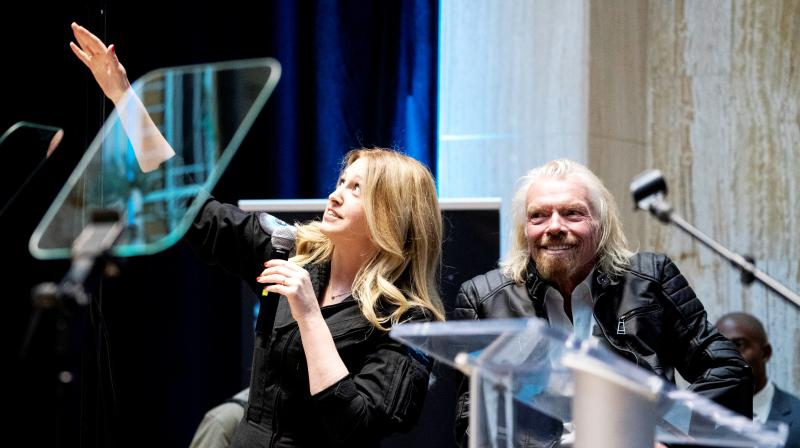 Beth Moses, chief astronaut instructor, describes her flight into space while on stage with Virgin Galactic founder Sir Richard Branson (right), during an event announcing the company's move to New Mexico. (Photo: AP)