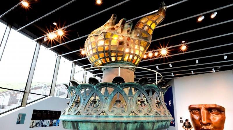 The original torch and flame, and full scale face model are displayed in the new Statue of Liberty Museum, on Liberty Island in New York. (Photo: AP)